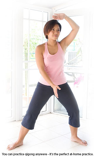 female doing qigong