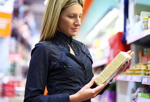 woman-reading-food-label-in-groccery-store.jpg